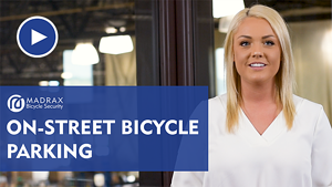 On-Street Bike Parking Video Still Image with Play Button 2